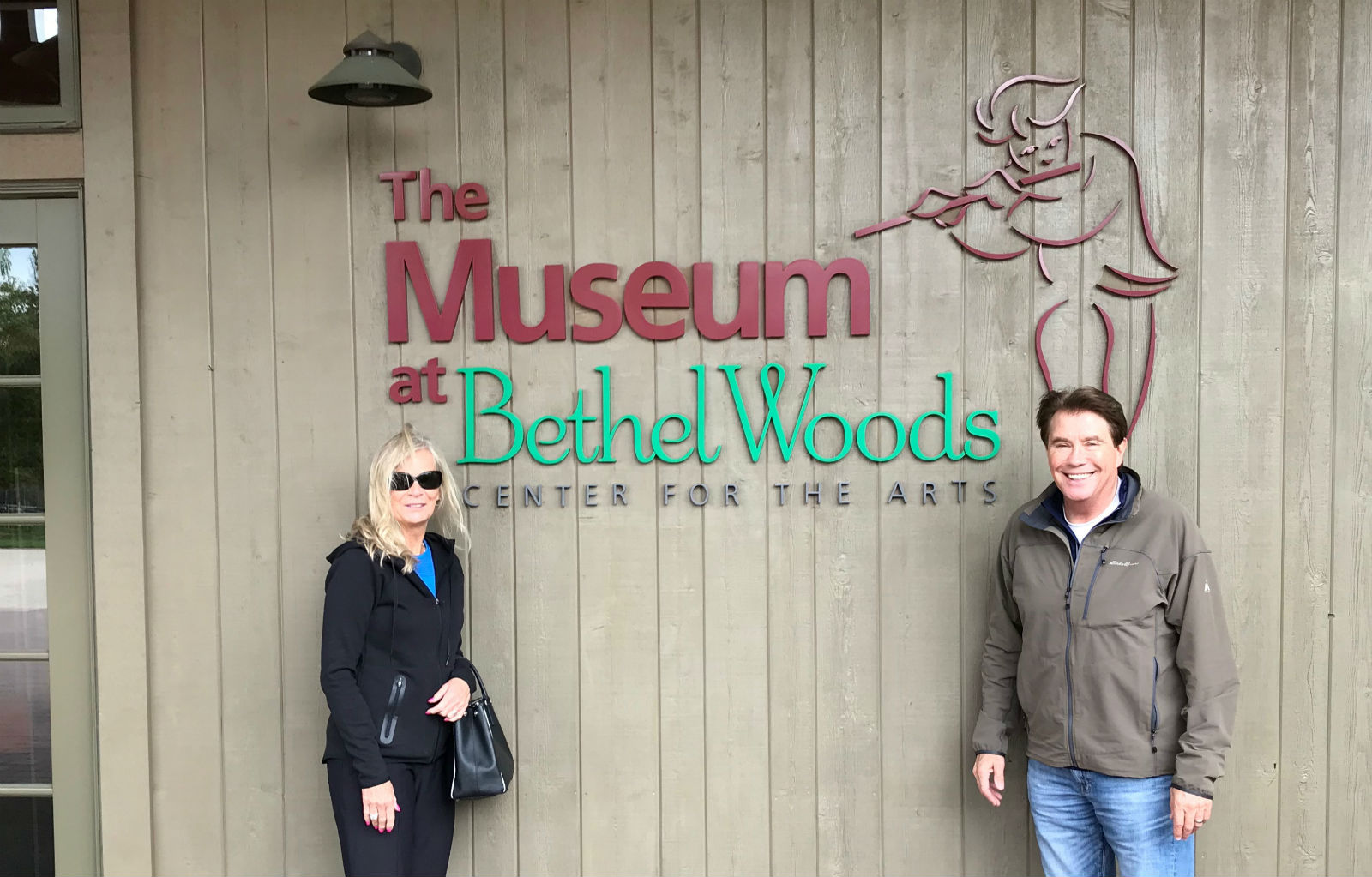 Bill and Sandy Hawkins in front of museum sign