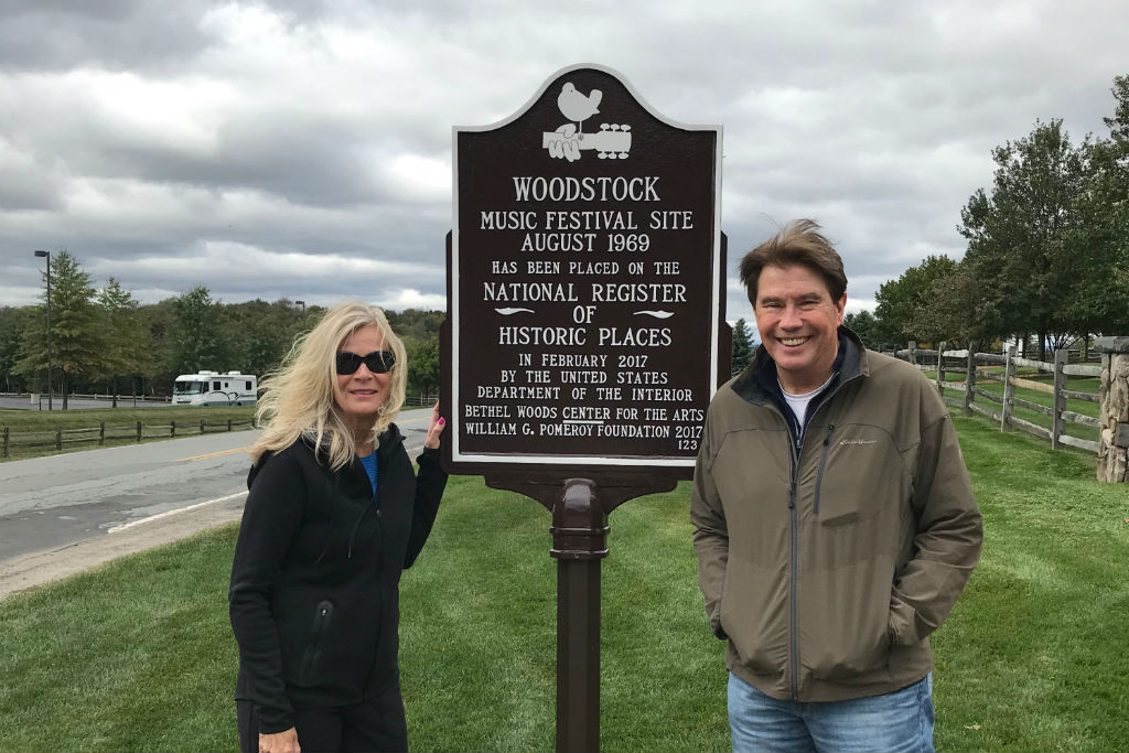 Bill and Sandy Hawkins next to Woodstock sign